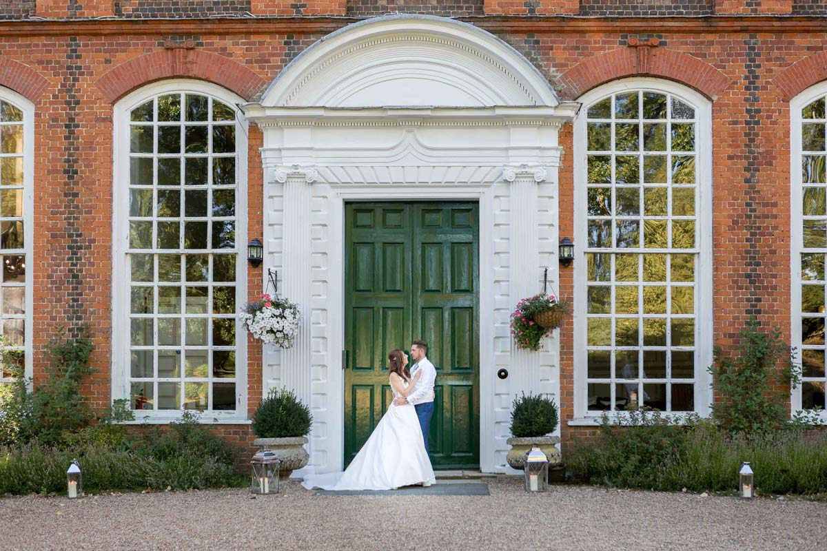 Bride and groom outside Gosfield Hall wedding venue