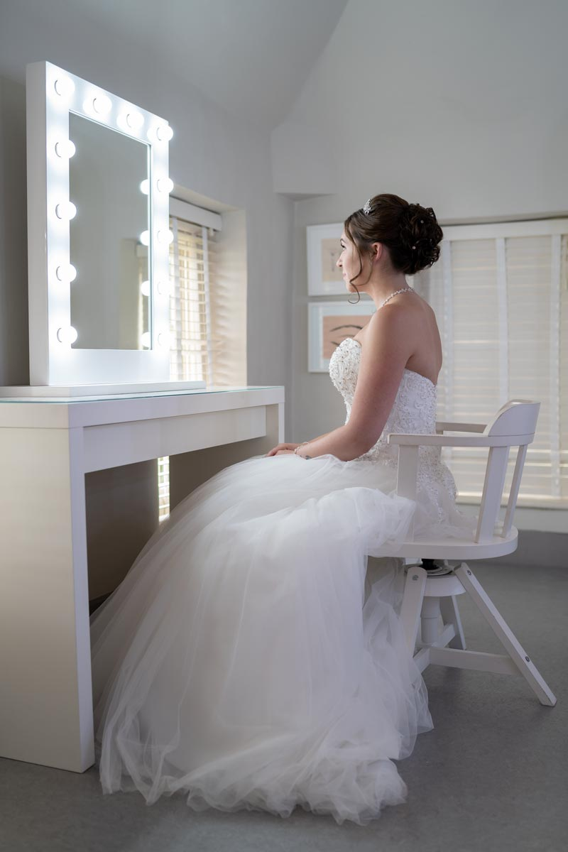 Bride getting ready in the Quendon Hall bridal suite