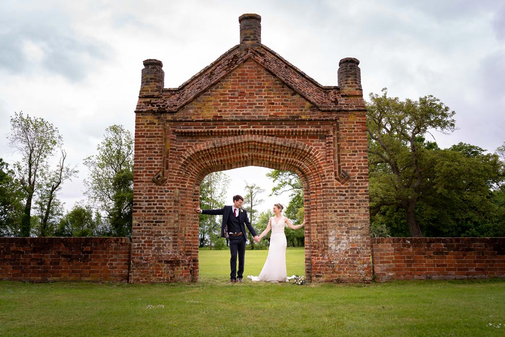 bride and groom couple shot at Colville Hall under the brick archway