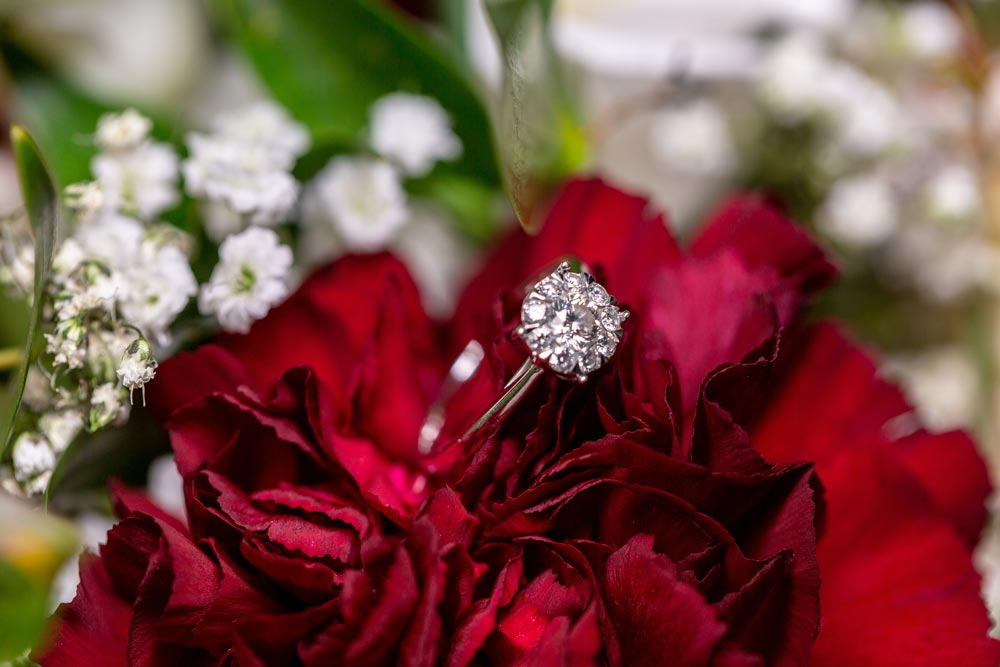 Brides engagement ring on a beautiful bouquet