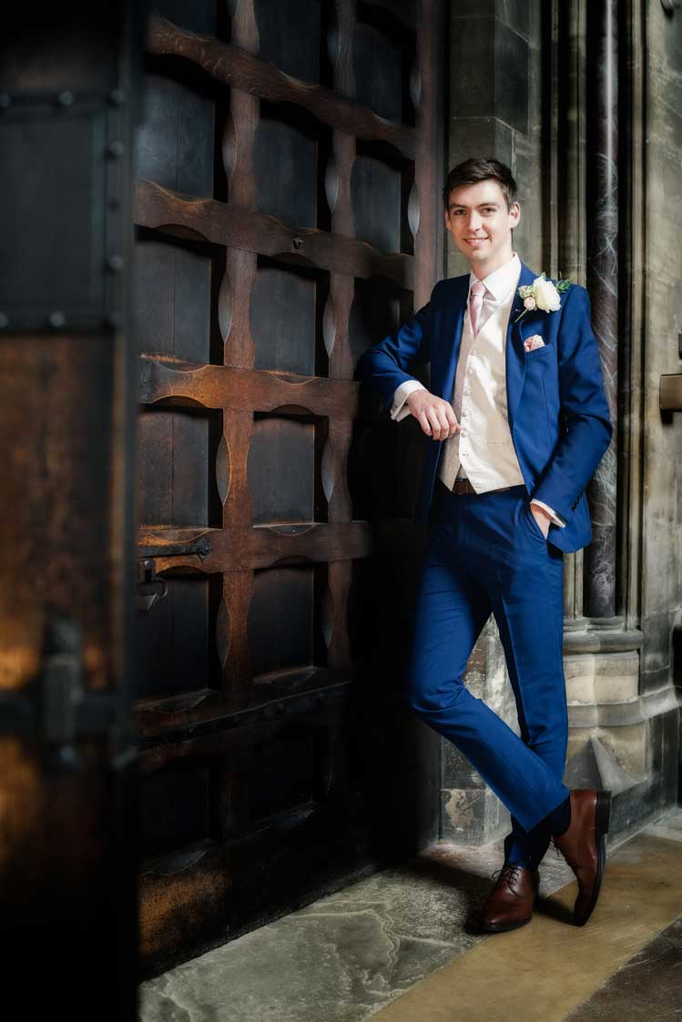 Groom standing at the St John's College Chapel entrance