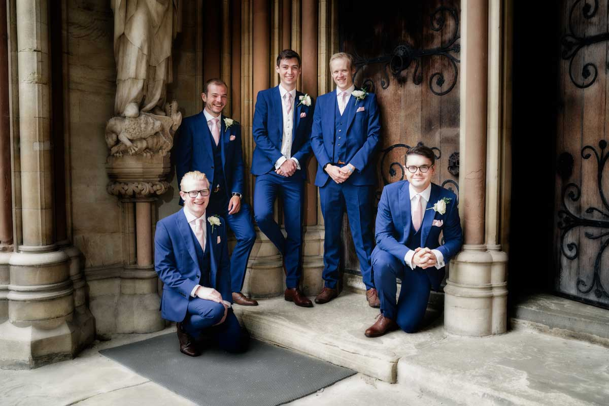 The groom and his groomsmen playing it nice and cool at St Johns College in Cambridge