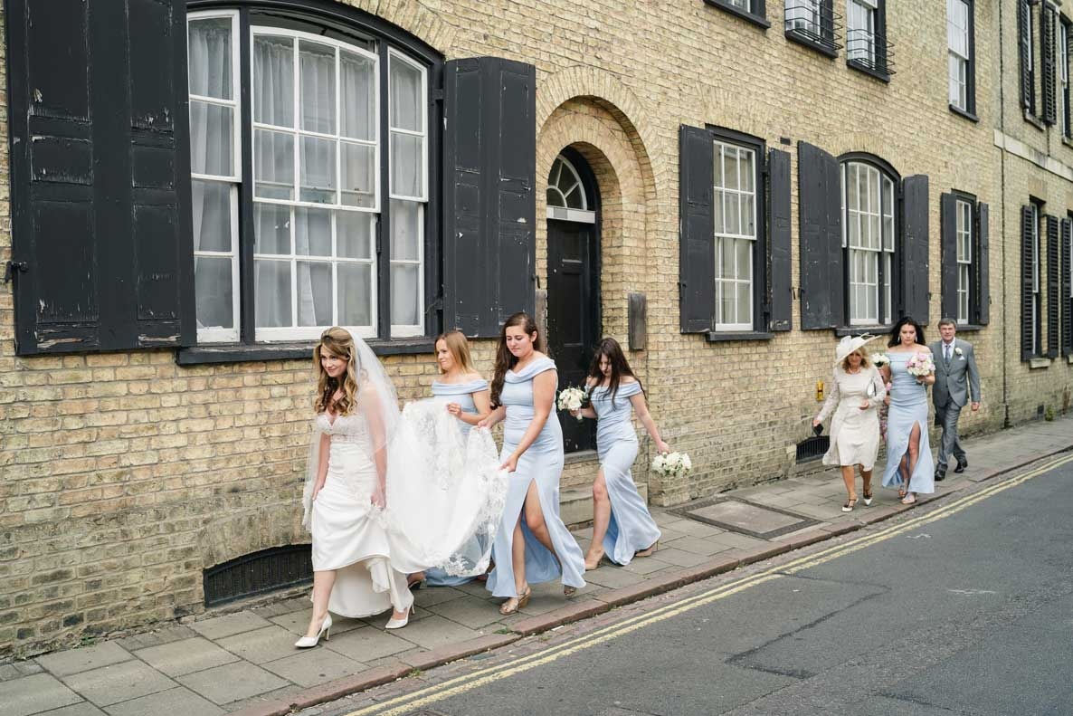 Bridal party walking through the streets of Cambridge