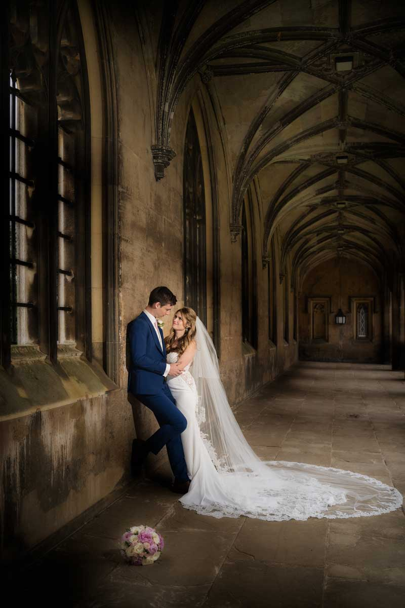 Bride and Groom taking a moment away from the guests at St Johns College in Cambridge