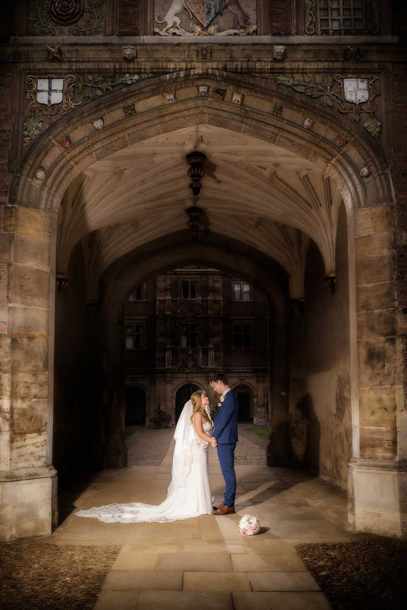 A romantic twilight moment for the bride and groom at St Johns College