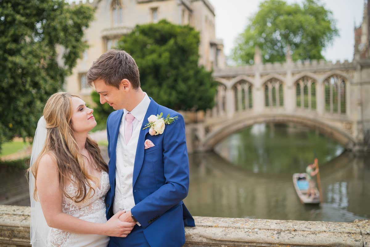 Bride and groom on the bridge at St Johns College
