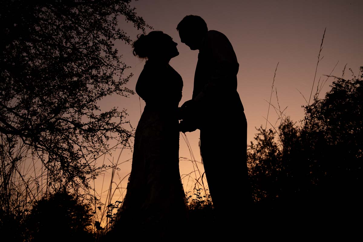 Silhouette of the bride and groom at Wat Tyler Country Park