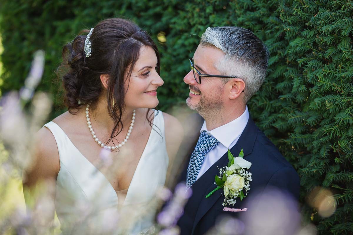 Bride and groom portrait during their couple session at The White Hart at Great Yeldham