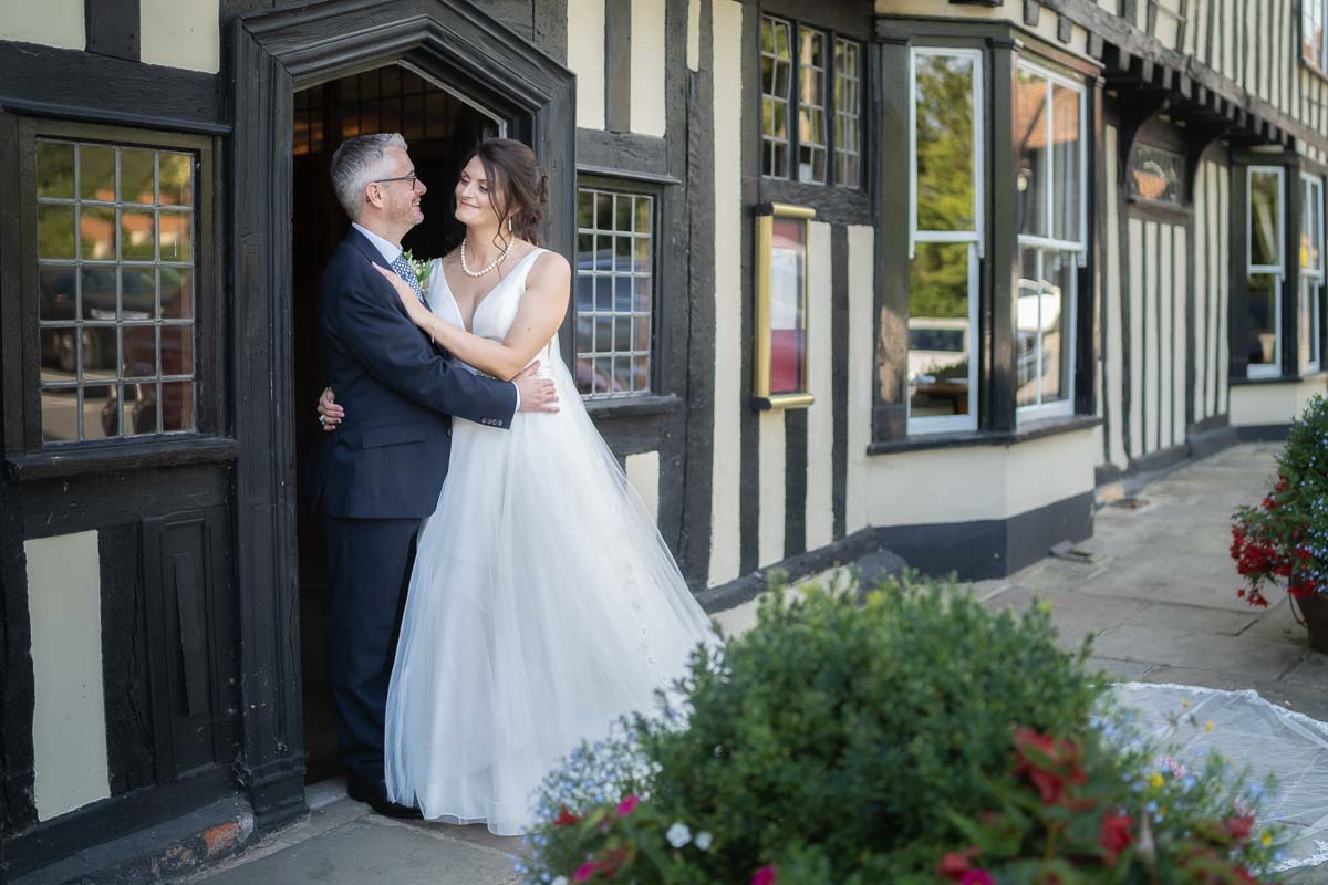 Bride and groom outside portrait during their wedding day at The White Hart at Great Yeldham