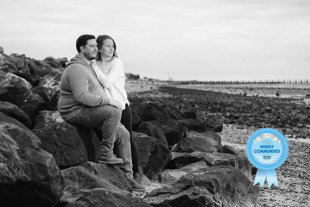 Engaged couple on the beach at Shoeburyness Seafront in Essex