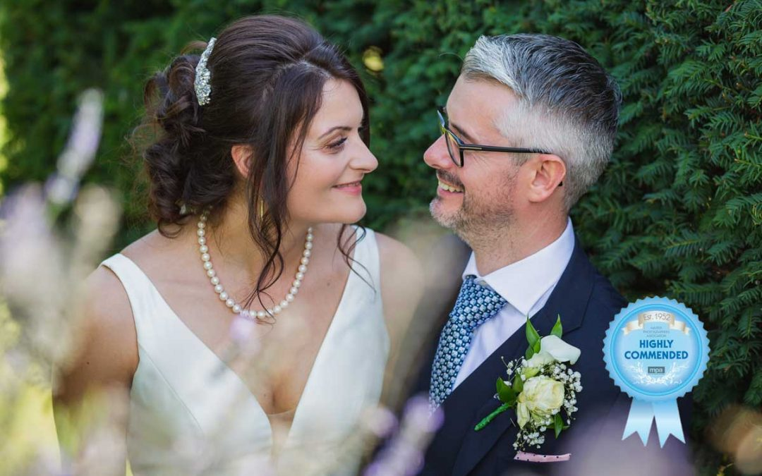 Newly married couple on their wedding day at The White Hart at Great Yeldham