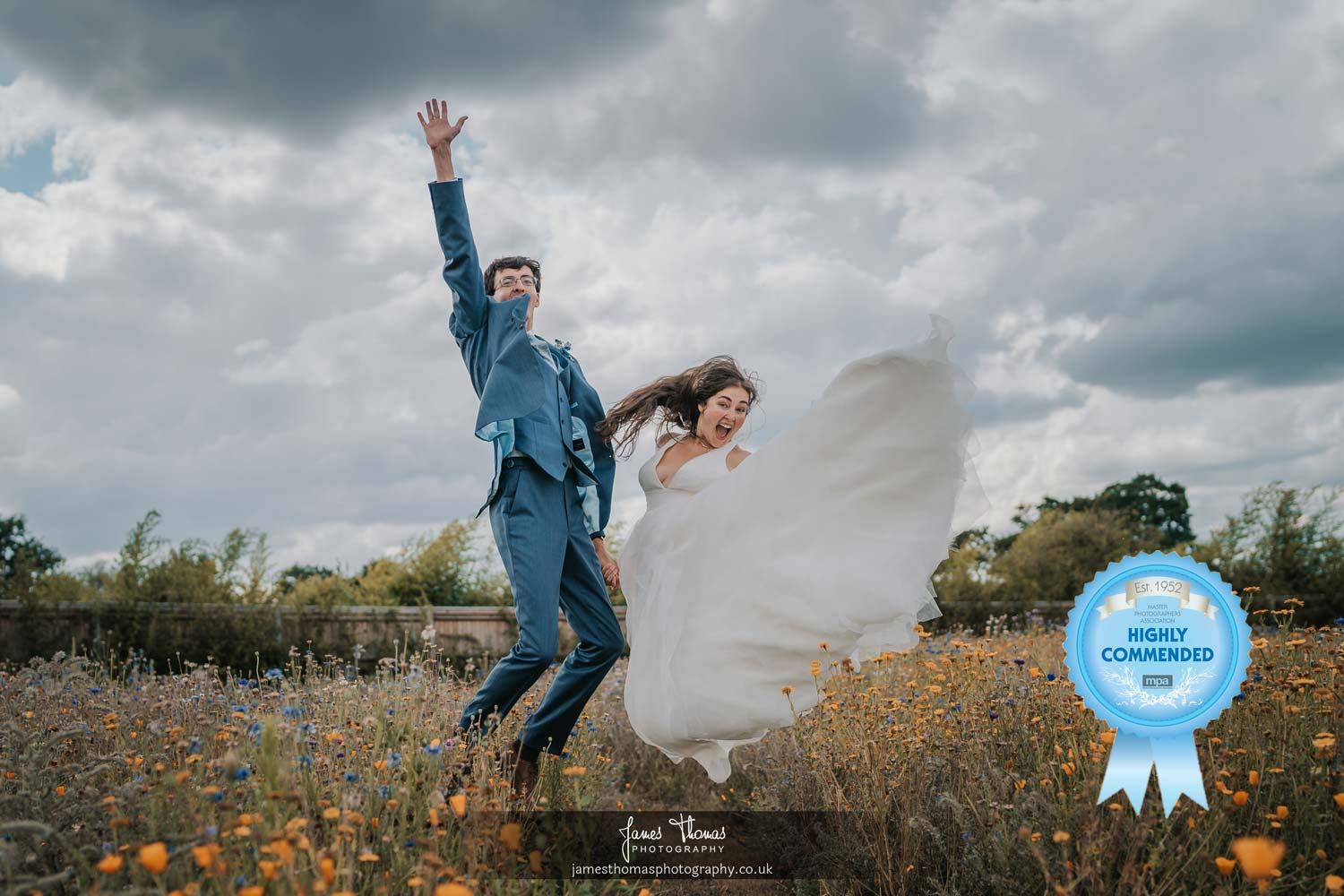 Bride and groom jumping in the air